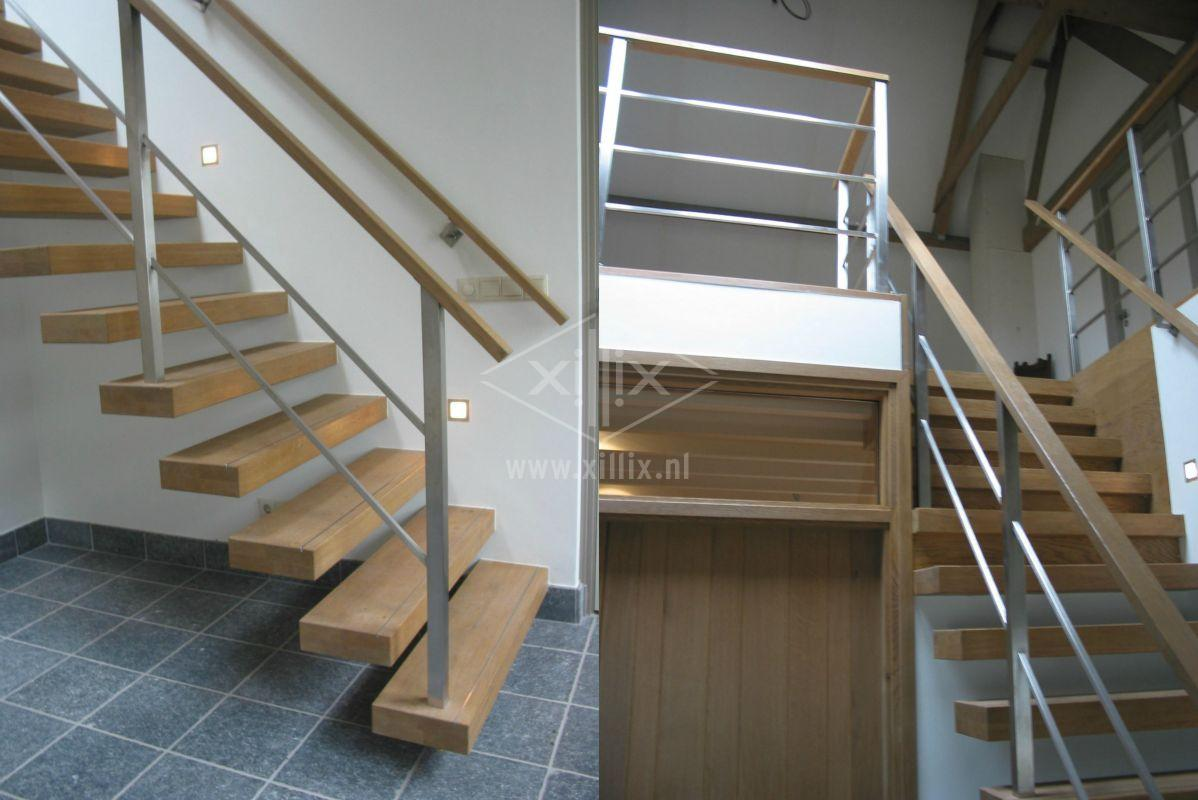 trap xillix met eiken vrijdragende treden en hek met vierkante balusters
